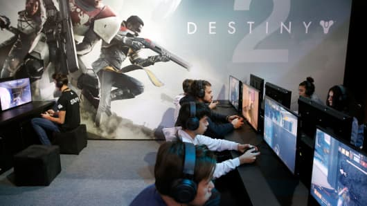 Gamers play the video game 'Destiny 2' developed by Bungie Studios and published by Activision during the 'Paris Games Week' on October 31, 2017 in Paris, France.