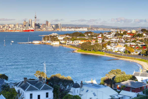 New Zealand, Auckland, Waitakere Harbour, Elevated View over Devenport towards CBD with Sky Tower at dawn