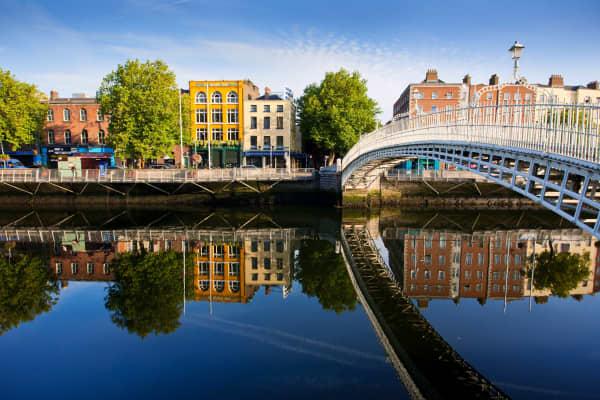 View of Ha'penny bridge on bright sunny day in Dublin, Ireland.