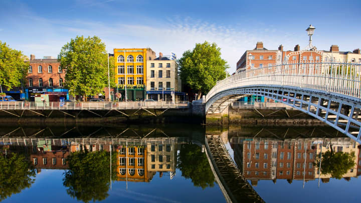 View of Ha'penny bridge on bright sunny day in Dublin, Ireland.