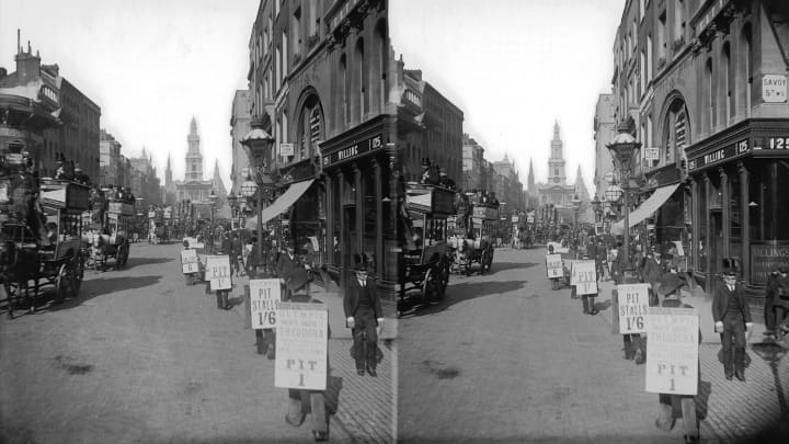 Sandwichboard men in the Strand advertise theatre seats, 1894. Savoy Street is on the right and the church of St Mary-le-Strand is in the background.