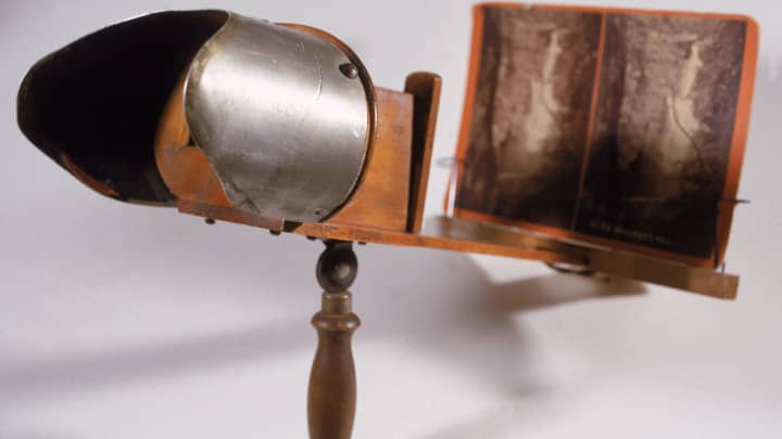 View of an antique Stereoscope, or 3-D veiwer, early 1900s. The stereo image card in the viewer shows the Raymond Kill waterfall in Pennsylvania.