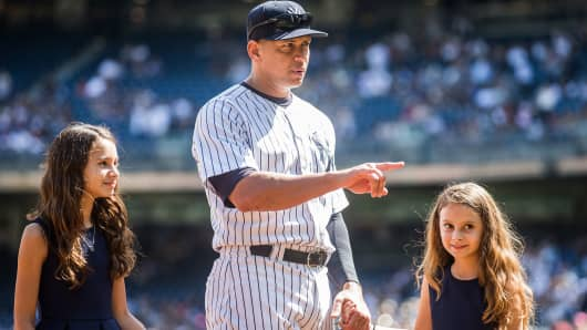 Alex Rodriguez #13 of the New York Yankees enters the field with daughters Natasha and Ella during the pre-game ceremony honoring Alex's 3000th hit before the game against the Toronto Blue Jays at Yankee Stadium on September 13, 2015 in the Bronx borough of New York City.