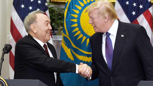 President Donald Trump shakes hands with President Nursultan Nazarbayev of Kazakhstan during a joint press conference in the Roosevelt Room of the White House January 16, 2018 in Washington, DC.