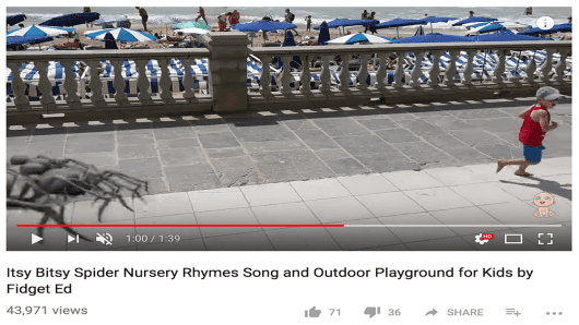 "A child gets chased around a playground by giant spiders while the ""Itsy Bitsy Spider"" nursery rhyme song plays."