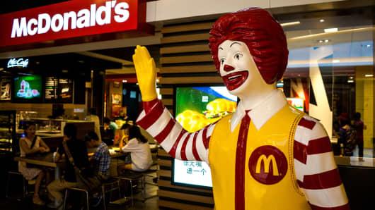 Ronald McDonald in a McDonalds restaurant.