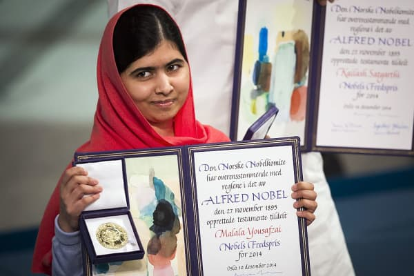 Nobel Peace Prize laureate Malala Yousafzai displays her medal and diploma during the Nobel Peace Prize awards ceremony at the City Hall in Oslo, Norway, on December 10, 2014.