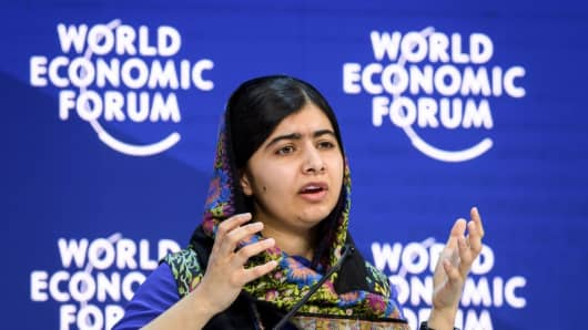 Pakistani Nobel Peace Prize Malala Yousafzai gestures while talking during a session at the Economic Forum (WEF) annual meeting on January 25, 2018 in Davos, eastern Switzerland