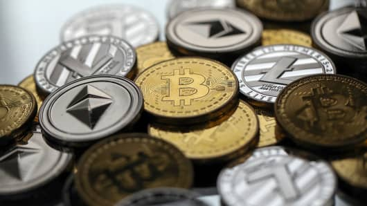 A collection of bitcoin, litecoin and ethereum tokens.
