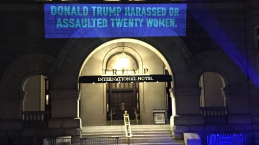 A group is projecting messages outside the Trump International Hotel in Washington D.C. ahead of the State of the Union tonight.