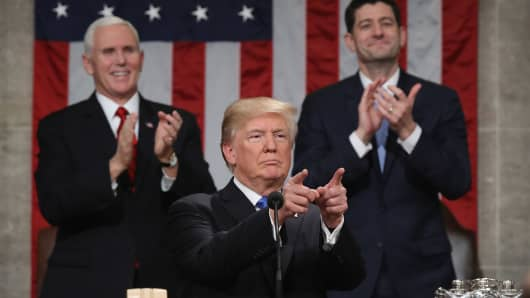 President Donald J. Trump delivers the State of the Union address as U.S. Vice President Mike Pence (L) and Speaker of the House U.S. Rep. Paul Ryan (R-WI) (R) look on in the chamber of the U.S. House of Representatives January 30, 2018 in Washington, DC.