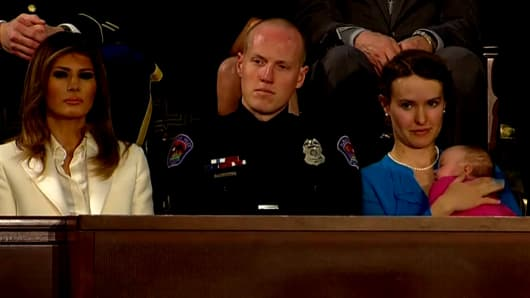 First Lady Melania Trump, Albuquerque Police Office Ryan Holets, Rebecca Holets, and their adopted daughter Hope, whose mother was a homeless heroin addict.