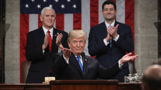 President Donald Trump, center, gestures while delivering a State of the Union address to a joint session of Congress at the U.S. Capitol in Washington, D.C., U.S., on Tuesday, Jan. 30, 2018.