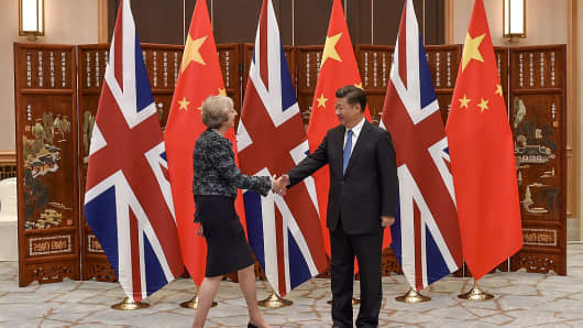 Chinese President Xi Jinping (R) shakes hand with British Prime Minister Theresa May (L) before their meeting in Hangzhou, China during the 11th G20 Leaders Summit.
