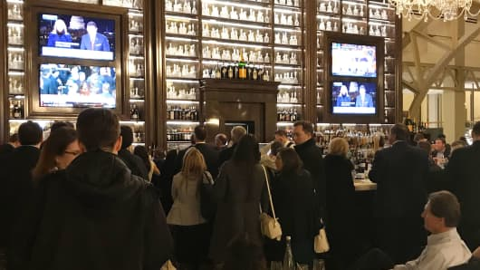 People watch President Donald Trump deliver his first State of the Union address at the Trump International Hotel in Washington, D.C.