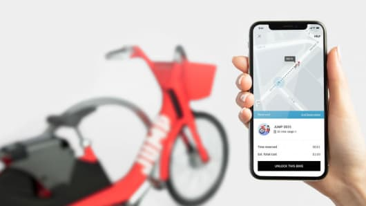 Uber to roll out a pilot bike share program.