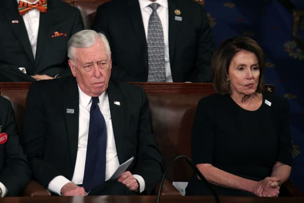U.S. Rep Steny Hoyer, D-Md., and U.S. House Minority Leader Nancy Pelosi, D-Calif., watch during the State of the Union address in the chamber of the U.S. House of Representatives January 30, 2018 in Washington, DC.