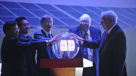 Warren E. Buffett, Charlie Munger and Bill Gates attend a BYD product launch in Beijing, China in 2010.
