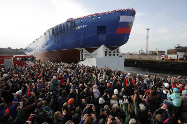 "People attend a ceremony to float out the nuclear-powered icebreaker ""Sibir"" (Siberia), which is under construction, at the Baltic Shipyard in St. Petersburg, Russia September 22, 2017."