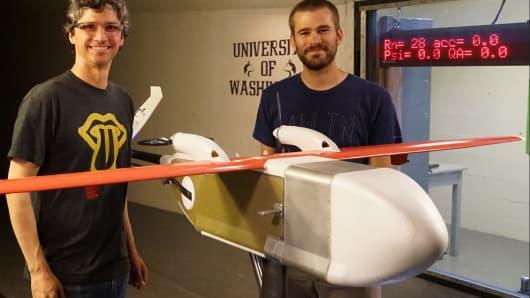 Investor Paul Willard and Zipline engineer Brian Boomgaard test a drone in a wind tunnel.