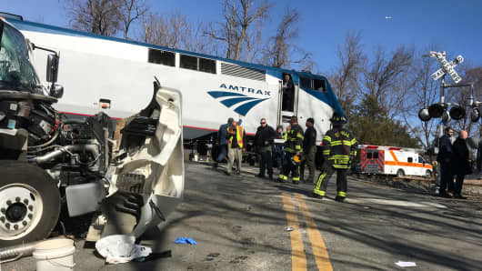 Emergency first responders work at the scene of the crash where an Amtrak passenger train carrying Republican members of the U.S. Congress from Washington to a retreat in West Virginia collided with a garbage truck in Crozet, Virginia, January 31, 2018.