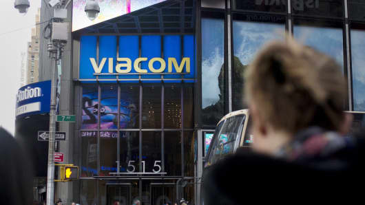 Pedestrians walk past the Viacom headquarters building in the Times Square area of New York.