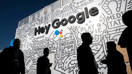 The silhouettes of attendees are seen at the Google booth during the 2018 Consumer Electronics Show (CES) in Las Vegas, Jan. 11, 2018.