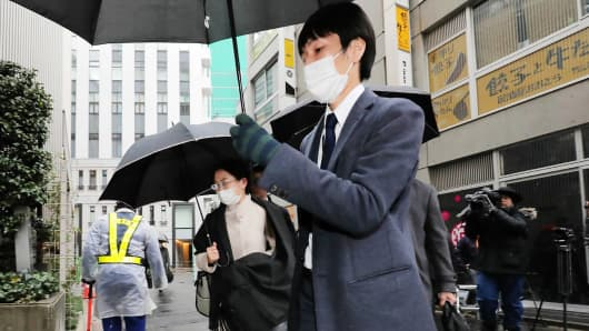 Officials of the Financial Services Agency enter Coincheck's headquarters to conduct a search, in Tokyo's Shibuya district on February 2, 2018. Japanese authorities on February 2 raided virtual currency exchange Coincheck, a week after the Tokyo-based firm lost 530 million USD in cryptocurrency to hackers.