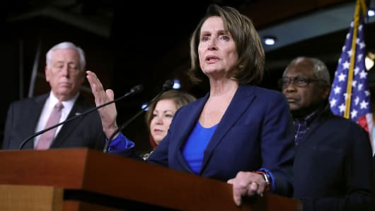 House Minority Leader Nancy Pelosi (D-CA) talks to reporters with (L-R) House Minority Whip Steny Hoyer (D-MD), Rep. Linda Sanchez (D-CA) and Rep. James Clyburn (D-SC) during a news conference at the U.S. Capitol January 31, 2018 in Washington, DC.
