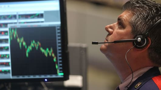 A trader works on the floor of the New York Stock Exchange after the closing bell in New York City.