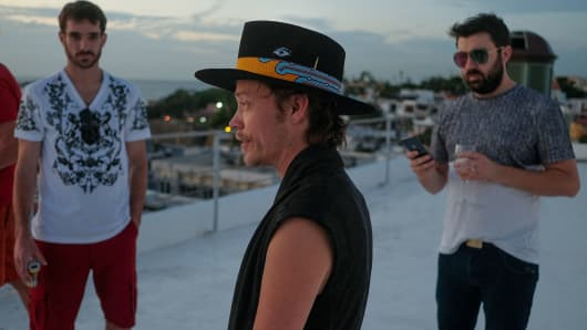 Brock Pierce, center, with Josh Boles, left, and Matt Clemenson on the roof of the Monastery Art Suites, which they have rented out as a headquarters for their cryptocurrency business, in San Juan, in Puerto Rico, on Jan. 3, 2018.