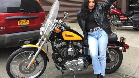 Kelly Yun, with her Sportster 1200 Custom motorcycle, loves the Harley-Davidson brand.