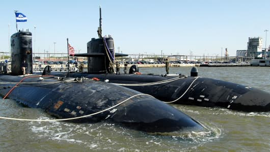 The U.S. Navy's nuclear fast-attack submarine, the USS Newport News (R), secures itself next to its sister Los Angeles-class submarine USS Boise (L) at Norfolk Naval Station in Norfolk, Va.