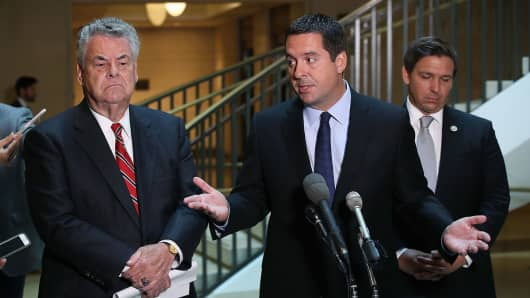 House Intelligence Committee Chairman Devin Nunes  stands with Rep. Peter King, and Rep. Don De Santis as he announces that his committee and the House oversight committee are starting the investigation into Russia and Obama Admi