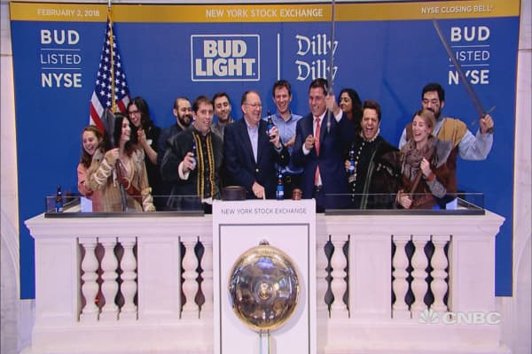 Anheuser-Busch InBev and Bud Knight ring the closing bell at the NYSE