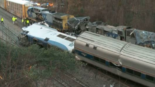 In this image from video, train cars are smashed and derailed Sunday, Feb. 4, 2018 near Cayce. S.C. The crash left multiple people dead and dozens of people injured.