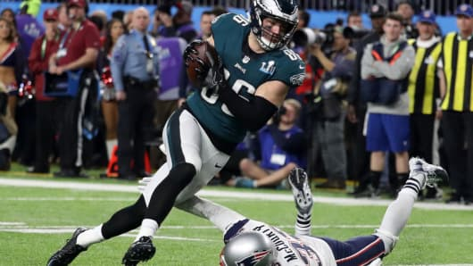 Zach Ertz #86 of the Philadelphia Eagles scores an 11-yard fourth quarter touchdown past Devin McCourty #32 of the New England Patriots in Super Bowl LII at U.S. Bank Stadium on February 4, 2018 in Minneapolis, Minnesota