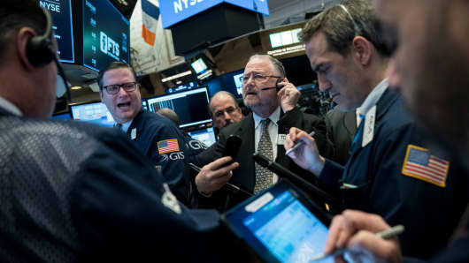 Traders and financial professionals work on the floor of the New York Stock Exchange (NYSE) ahead of the opening bell.