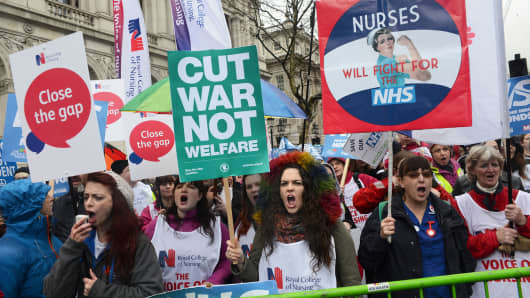 Protesters seen shouting slogans while holding several placards and posters during the demonstration. Thousand of people marched in London in a protest called 'NHS in crisis - fix it now' to call for government action to demand the end of NHS crisis.