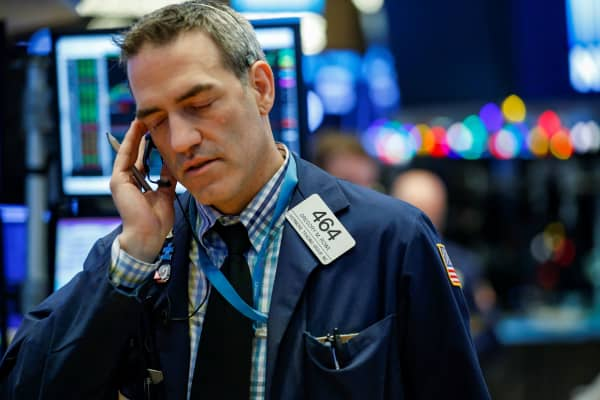 Traders work on the floor of the New York Stock Exchange, (NYSE) in New York, U.S., January 8, 2018.