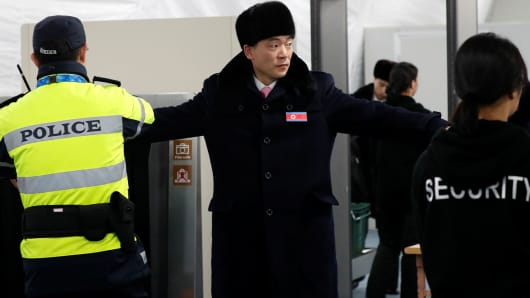 A man passes through a security check as a North Korean delegation of 32 people, including 10 athletes of North Korean Olympic team, arrives at the Gangneung Olympic Village of the Pyeongchang Winter Olympic Games 2018, in Gangneung, South Korea, February 1, 2018.