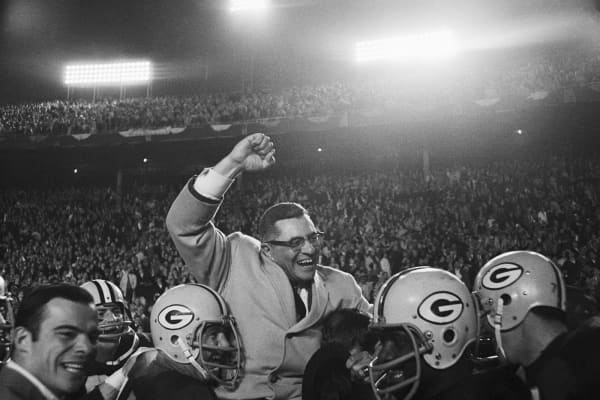 Vince Lombardi being carried by Green Bay Packers players after defeating the Dallas Cowboys.