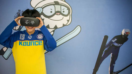 A South Korean child tries out the virtual reality simulator to experience Ski Jumping on February 3, 2017 in Seoul, South Korea. South Koreans enjoy and experience the upcoming winter olympic games' categories at the Lotte World Mall one year before the 2018 PyeongChang Winter Olympic and Paralympic Games.