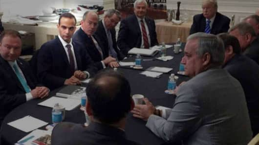 George Papadopoulos sitting in on a policy meeting with President Trump.