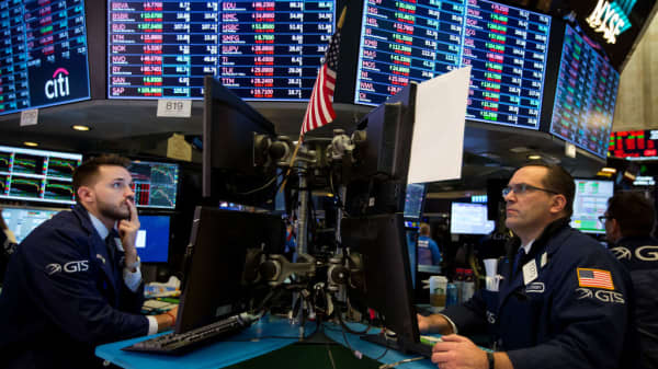 Traders work on the floor of the New York Stock Exchange on Monday, Feb. 5, 2018. U.S. stocks plunged, as major averages erased gains for the year.