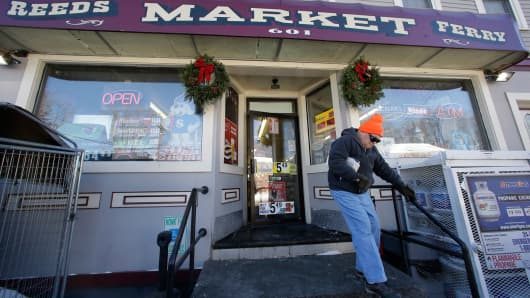 A customer departs Reeds Ferry Market convenience store, Sunday, Jan. 7, 2018, in Merrimack, N.H. A lone Powerball ticket sold at the convenience store matched all six numbers and will claim a $570 million jackpot.