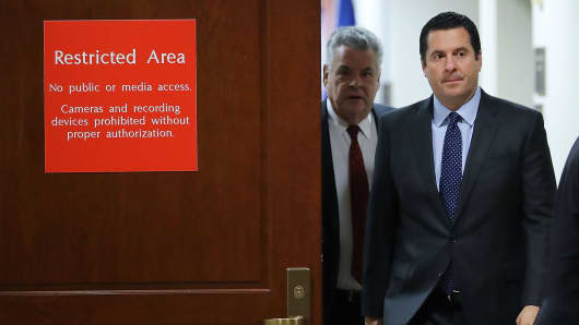 House Intelligence Committee Chairman Devin Nunes (R-CA) (2nd L) and Rep. Peter King (R-NY) leave the committee's secure meeting rooms in the basement of the U.S. Capitol House Visitors Center February 6, 2018 in Washington, DC.