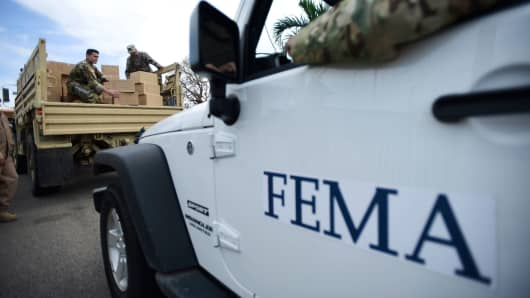 FEMA personnel deliver supplies to Santa Ana community residents in the aftermath of Hurricane Maria in Guayama, Puerto Rico.