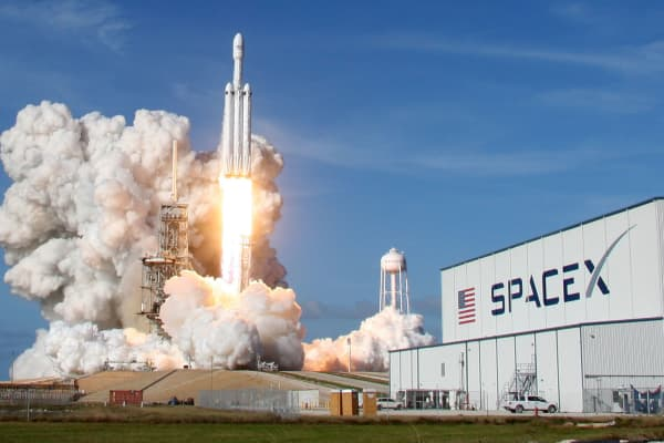 A SpaceX Falcon Heavy rocket lifts off from historic launchpad 39-A at the Kennedy Space Center in Cape Canaveral, Florida, on Feb. 6, 2018.