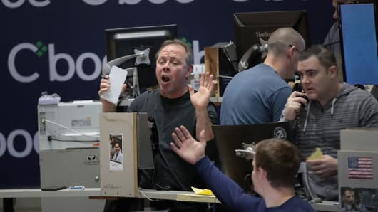 Traders signal offers in the VIX pit at the Cboe Global Markets exchange.